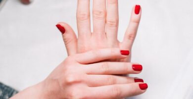 person with red nail polish