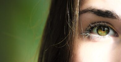 selective focus half face closeup photography of female s green eyes